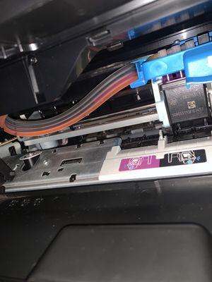 Mangueiras da impressora por dentro.